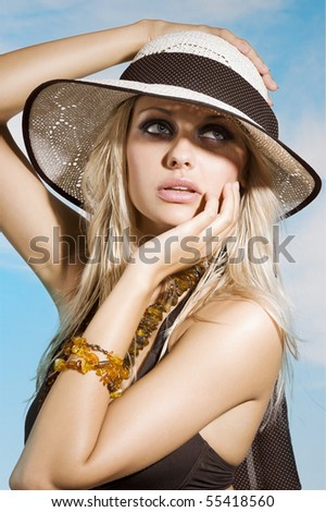 closeup portrait of pretty blond woman in summer suit against a sky - stock photo