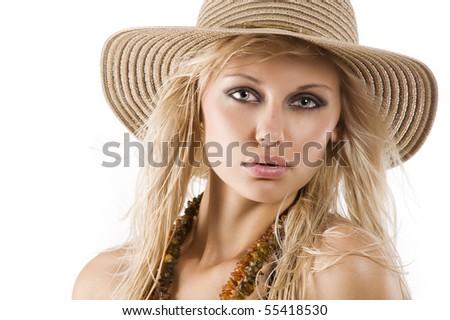 closeup portrait of pretty blond woman wearing a nice summer hat - stock photo