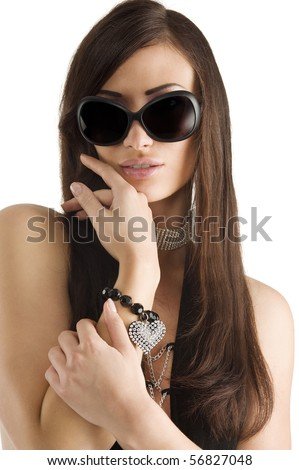 closeup portrait of pretty brunette with long dark hair sunglasses and jewelery