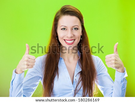 Closeup portrait of pretty, friendly, pleased young smiling business woman giving two thumbs up at camera sign isolated on green background. Positive human emotions facial expression feelings. Symbols - stock photo