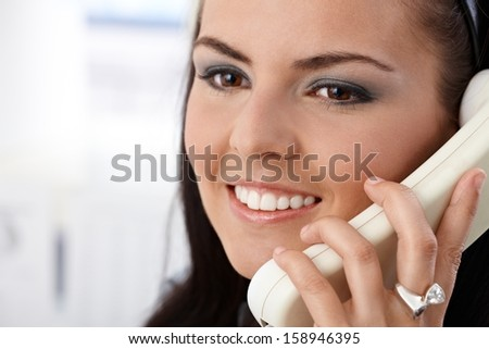 Closeup portrait of pretty girl talking on phone, smiling. - stock photo