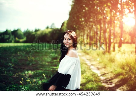 Closeup portrait of pretty girl walking outdoor