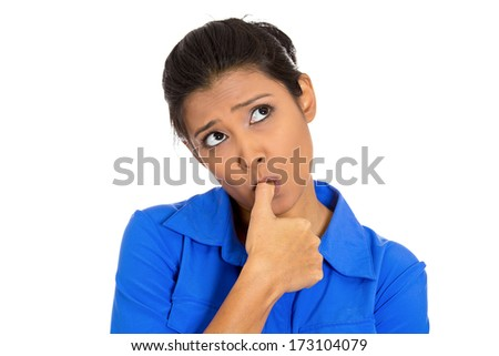 Closeup portrait of pretty woman with finger in mouth, sucking thumb, biting fingernail in stress, deep thought, isolated on white background. Negative emotion facial expression feeling. Body language