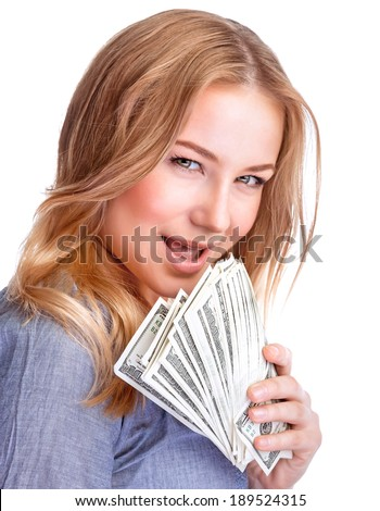 Closeup portrait of pretty woman with leer holding in hands a wad of dollars isolated on white background, spending money with pleasure concept - stock photo