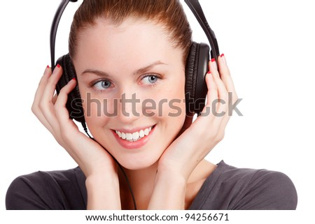 Closeup portrait of pretty young girl listening music. Isolated on white background - stock photo