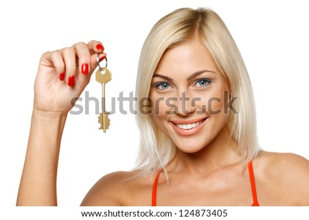 Closeup portrait of  pretty young lady holding key isolated on white background - stock photo