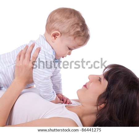 Closeup portrait of pretty young mother with her cute baby