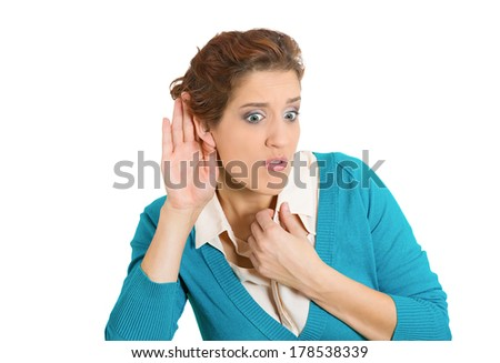 Closeup portrait of pretty young nosy woman hand to ear trying to carefully intently secretly listen in on a juicy gossip conversation news, privacy violation, isolated on white background - stock photo