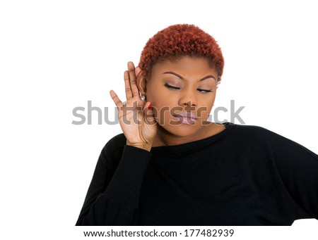 Closeup portrait of pretty young, nosy woman trying to secretly listen in on conversation, hand to ear surprised at juicy gossip she hears, thinking, privacy violation, isolated on white background - stock photo