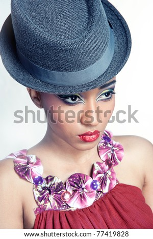 Closeup portrait of pretty young showgirl wearing a hat, isolated on white, wide angle lens effect
