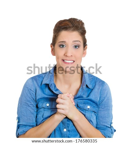 Closeup portrait of pretty young woman gesturing with clasped, pretty please with sugar on top, isolated on white background. Positive emotion facial expression feelings, signs symbols, body language. - stock photo