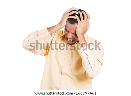 Closeup portrait of really stressed out young man, handsome student with headache, having bad day at work, school, university, isolated on white background. Negative emotion facial expression feelings - stock photo