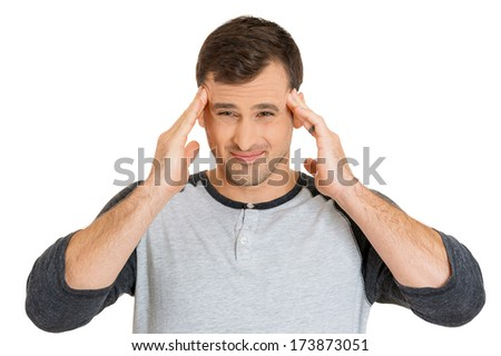 Closeup portrait of really stressed out young man, handsome student with headache, having bad day at work, school, university, isolated on white background. Negative human emotions, facial expressions - stock photo