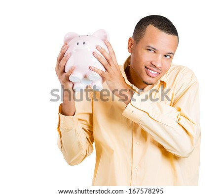 Closeup portrait of rich, happy, excited young successful man introducing his friend, the piggy bank, isolated on white background. Financial money savings, earnings. Positive face expression, emotion - stock photo