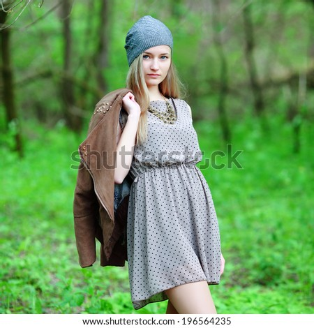 Closeup portrait of romantic fashion young woman smile in the woods. - stock photo
