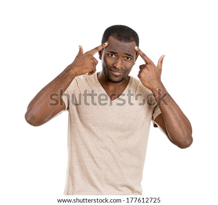 Closeup portrait of rude difficult, angry, young man gesturing with his fingers against temples are you crazy? Isolated on white background. Negative human emotions facial expression feelings attitude