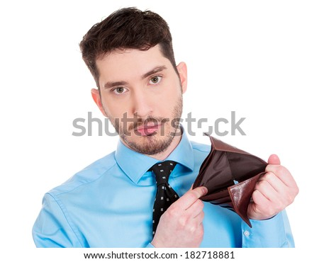 Closeup portrait of sad, upset, unemployed broke guy, fired employee, jobless business man, holding, showing his empty wallet, isolated on white background. Bankruptcy, financial problems, mistakes - stock photo
