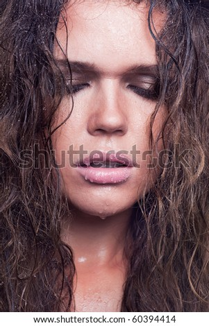closeup portrait of sad young adult with wet hair - stock photo
