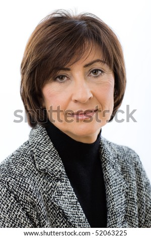 Closeup portrait of senior businesswoman wearing grey suit, smiling and looking at camera. Isolated on white background. - stock photo
