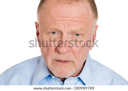 Closeup portrait of senior elderly mature depressed man really sad, deep in thought, thinking realizing truth looking down isolated on white background. Human face expression emotion feeling, reaction - stock photo