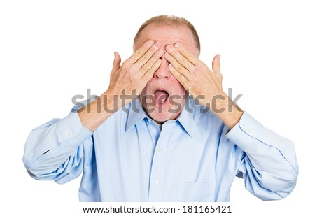 Closeup portrait of senior mature, coy man closing eyes with hands can't see and hiding mouth wide open, isolated on white background. See no evil concept. Negative emotion facial expression feelings