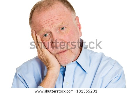 Closeup portrait of senior mature depressed man really sad, deep in thought, realizing truth looking down, hand on cheek, isolated on white background. Human face expression emotion feeling, reaction