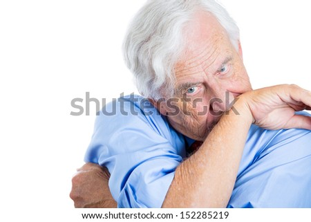 Closeup portrait of senior mature, elderly man very nervous, stressed, and thinking about something making him crazy, isolated on white background with copy space - stock photo