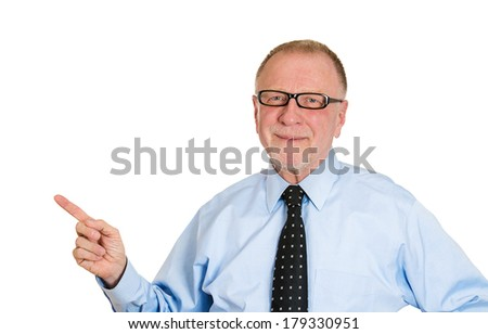 Closeup portrait of senior mature happy smiling business man in glasses, pointing at copy space to left, isolated on white background. Positive emotions, facial expressions, corporate successful life - stock photo