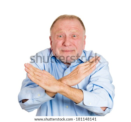 Closeup portrait of senior mature man with hands in X sign telling someone to stop talking, isolated white background. Negative emotion, facial expression feelings, body language symbols. Conflict