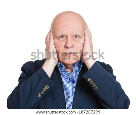 Closeup portrait of senior mature, peaceful, tranquil, looking relaxed, business man covering his ears, observing, isolated white background. Hear no evil concept. Human emotion, facial expressions - stock photo