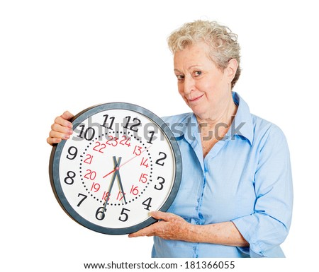 Closeup portrait of senior mature smiling business woman, successful happy old executive, banker, employee holding wall clock, isolated on white background. Human positive face expressions, emotions - stock photo