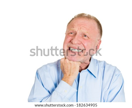 Closeup portrait of senior mature, unhappy man very sad in deep thought thinking of something that worries him, isolated on white background. Negative human emotions. Face expressions. - stock photo