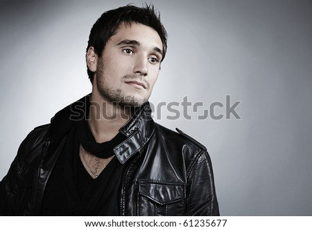 Closeup portrait of sensual man with beautiful face and eyes - stock photo