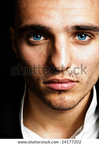 Closeup portrait of sensual man with blue eyes - stock photo
