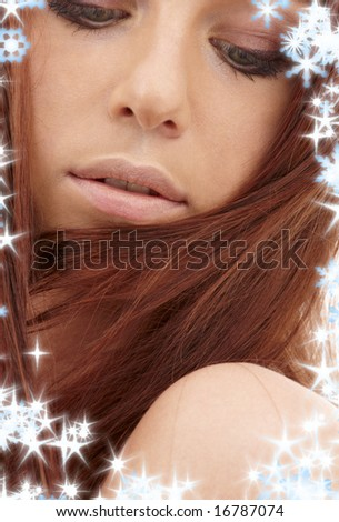 closeup portrait of sensual redhead with long hair and snowflakes - stock photo