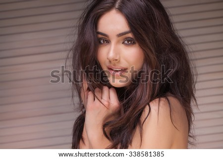 Closeup portrait of sensual woman with glamour makeup and long brown hair. - stock photo