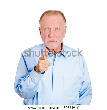 Closeup portrait of serious, staring senior mature man, pointing at you with index finger, hand sign gesture, isolated white background. Negative human emotions, facial expressions, feelings, symbols - stock photo
