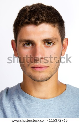 Closeup portrait of serious young man - stock photo