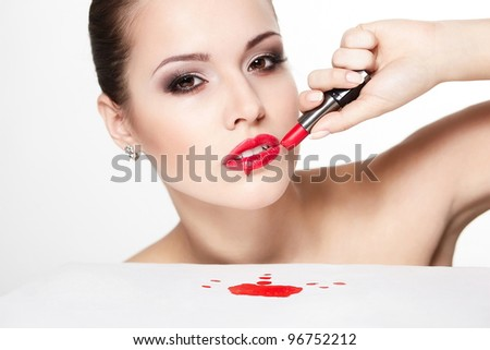 closeup portrait of sexy caucasian young woman model with glamour red lips,bright makeup, eye arrow makeup, purity complexion with red lipstick. Perfect clean skin. blood on table - stock photo