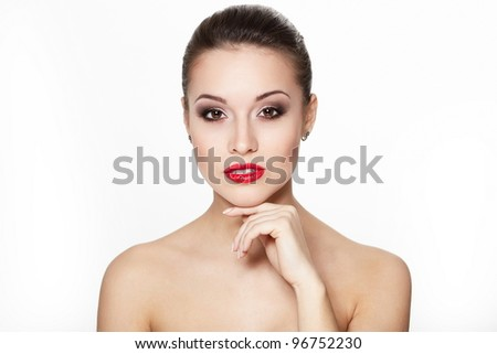 closeup portrait of sexy caucasian young woman model with glamour red lips,bright makeup, eye arrow makeup, purity complexion. Perfect clean skin. - stock photo