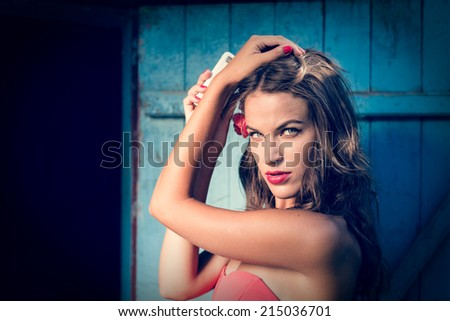 closeup portrait of sexy pinup young pretty girl having fun looking at camera posing on blue door copy space background - stock photo
