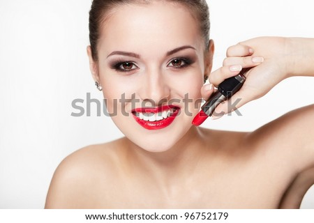 closeup portrait of sexy smiling caucasian young woman model with glamour red lips,bright makeup, eye arrow makeup, purity complexion with red lipstick. Perfect clean skin.white teeth - stock photo