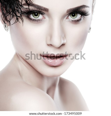 Closeup portrait of sexy whiteheaded young woman with black feather  on white  background