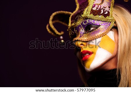 closeup portrait of sexy woman in violet party mask. good use for desire concept