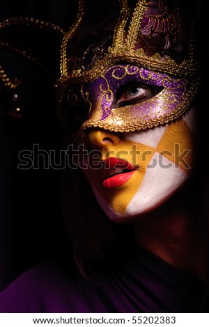 closeup portrait of sexy woman in violet party mask. may be use for desire concept