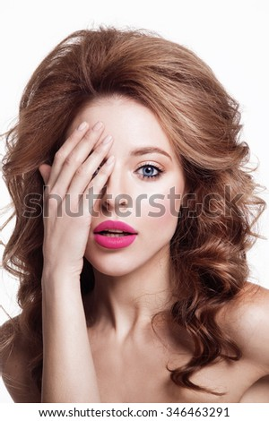 Closeup portrait of sexy young beauty girlwith blue eyes  touching her eyes. closed eyes.  Nude makeup with perfect clean skin with colourfull pink lips and curly hair.
