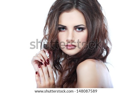 Closeup portrait of sexy  young woman with beautiful blue eyes on white background