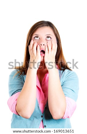 Closeup portrait of shocked, horrified, attractive, worried, stressed young girl, hands on face, isolated on white background. Negative human emotions, face expressions, feelings, reaction, perception - stock photo