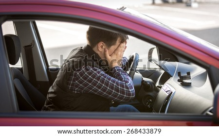 Closeup portrait of shocked male driver closing face with hands - stock photo