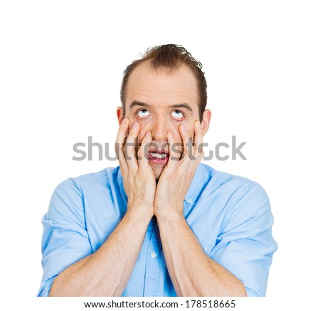 Closeup portrait of shocked, sad, horrified, worried, stressed young man hands on face, isolated on white background. Negative facial expressions, emotions, feelings, reaction, perception of situation